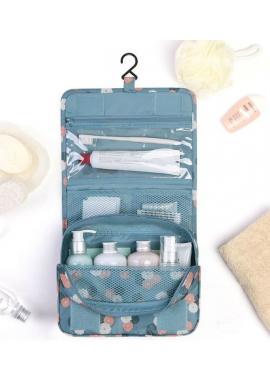 Kozmetická taška modrej farby s bodkovaným motívom