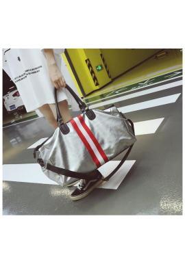 Dámska taška s kontrastnými pásmi v striebornej farbe