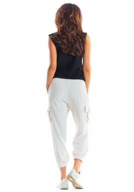 Športové dámske nohavice béžovej farby s voľným strihom