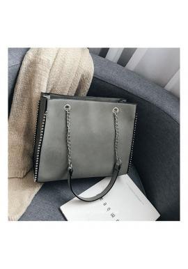 Elegantná dámska kabelka sivej farby so striebornými guličkami