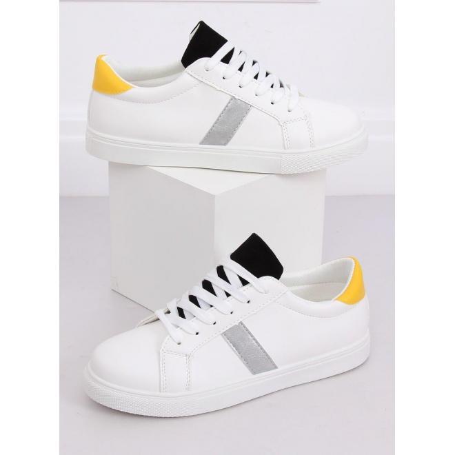 Klasické dámske tenisky bielo-čiernej farby s farebnými doplnkami