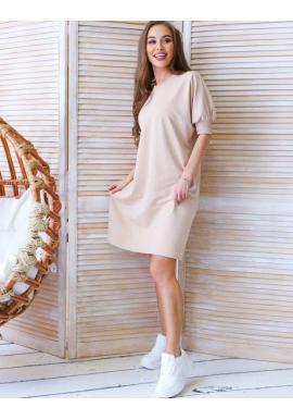 Voľné dámske šaty béžovej farby s malou potlačou
