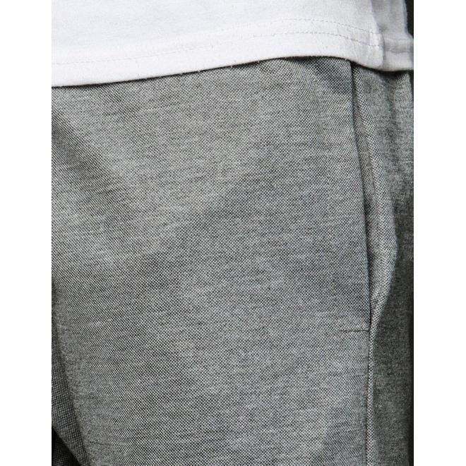 Módne pánske tepláky sivej farby s potlačou