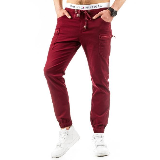 Pánske športové nohavice tmavomodrej farby s nižším sedom